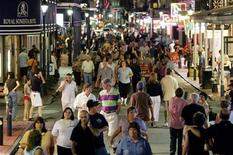 <p>Tourists walk on Bourbon street in the French Quarter neighborhood of New Orleans August 26, 2006. REUTERS/Carlos Barria</p>