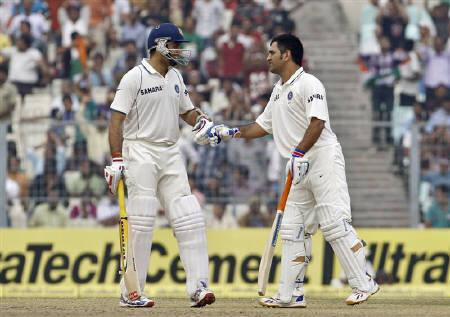 India's V.V.S. Laxman (L) speaks with his captain Mahendra Singh Dhoni on the second day of their second test cricket match against West Indies in Kolkata November 15, 2011. REUTERS/Rupak De Chowdhuri