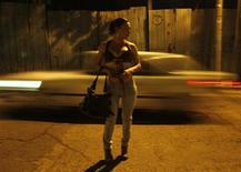 <p>A transgender prostitute waits for clients on a street in Tegucigalpa March 10, 2011. REUTERS/Edgard Garrido</p>