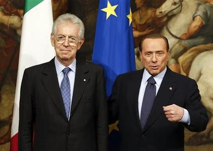 Newly appointed Prime Minister Mario Monti (L) poses with his predecessor Silvio Berlusconi at Chigi palace in Rome November 16, 2011. REUTERS/Stefano Rellandini