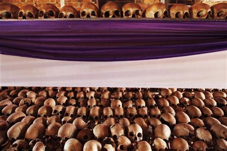 The skulls and bones of Rwandan victims rest on shelves at a genocide memorial inside the church at Ntarama just outside the capital Kigali, August 6, 2010. REUTERS/Finbarr O'Reilly
