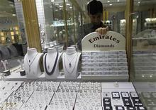 "<p>A jeweller puts up a sign in a window display at an ""Emirates Diamonds"" shop at Gold and Diamond Park, a shopping mall specialized in gold and diamond retailing, in Dubai November 15, 2011. The United Arab Emirates, the world's fourth-largest oil exporter and home to gold trading hub Dubai, is rapidly becoming a force in trade of another highly valuable commodity: diamonds. Dubai, the UAE's centre for gem trade, handled $35 billion worth of rough and polished diamonds in 2010, a leap from an annual figure of just $3 million a decade ago, according to Malcolm Wall Morris, chief executive of the Dubai Multi Commodities Centre (DMCC). Picture taken November 15, 2011. To match Feature DUBAI-DIAMONDS/ REUTERS/Jumana El Heloueh (UNITED ARAB EMIRATES - Tags: BUSINESS COMMODITIES)</p>"