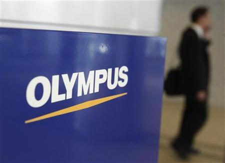 The logo of Olympus Corp is pictured at its company headquarters in Tokyo October 27, 2011. REUTERS/Yuriko Nakao )