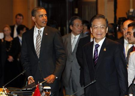 U.S. President Barack Obama (L) and Chinese Premier Wen Jiabao (R) stand together during preparations for the plenary session of the East Asia Summit in Nusa Dua, Bali November 19, 2011. REUTERS/Beawiharta (INDONESIA - Tags: POLITICS)