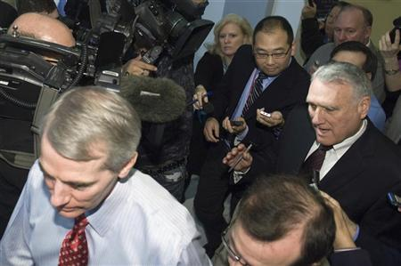 Senator Rob Portman (R-OH) (L) and Senator Jon Kyl (R-AZ) (R) depart a meeting with fellow members of the ''super committee'' on Capitol Hill in Washington, November 21, 2011. REUTERS/Jonathan Ernst