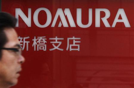 A man passes a branch of Nomura Securities in Tokyo November 1, 2011. REUTERS/Yuriko Nakao