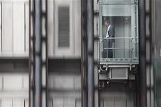 <p>A man descends in an elevator at the Lloyds of London insurance building in the City of London, September 28, 2010. REUTERS/Andrew Winning</p>