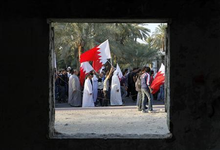 Family members and friends of Abdulnabi Kadhum Akel walk with Bahraini flags during his funeral procession in Aali, south of Manama November 24, 2011. REUTERS/ Hamad I Mohammed