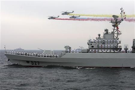 Helicopters fly past the Chinese Jiangwei II class naval frigate ''Luoyang'' at an international fleet review to celebrate the 60th anniversary of the founding of the People's Liberation Army Navy in Qingdao, Shandong province, April 23, 2009. REUTERS/Guang Niu/Pool
