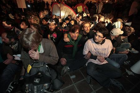 Protesters wait to be arrested at the Occupy LA encampment outside City Hall in Los Angeles November 30, 2011. REUTERS/Lucy Nicholson