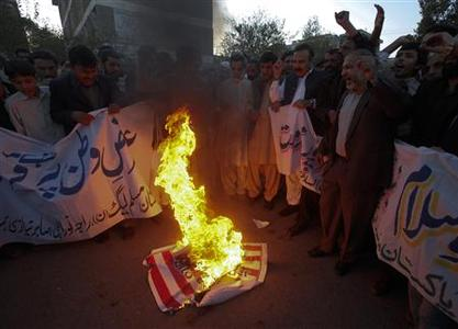 Supporters of Pakistan Muslim League (N) party shout anti-American slogans while burning the U.S. flag during a demonstration in Islamabad November 30, 2011. REUTERS/ Faisal Mahmood