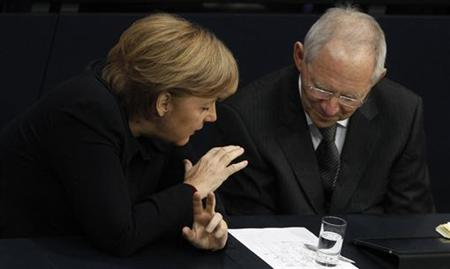 German Chancellor Angela Merkel (L) chats with Finance Minister Wolfgang Schaeuble during a session of German lower house of parliament Bundestag in Berlin December 2, 2011. REUTERS/Tobias Schwarz