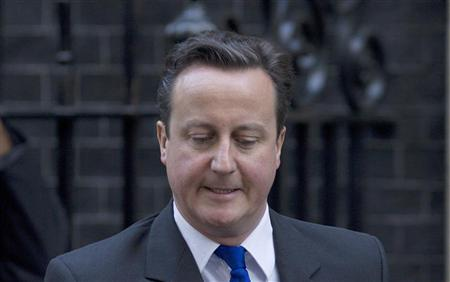 Prime Minister David Cameron leaves 10 Downing Street for Prime Minister's Questions in the Commons in central London November 30, 2011. REUTERS/Olivia Harris