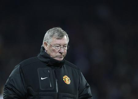 Manchester United's manager Alex Ferguson walks off the pitch after losing against FC Basel during their Champions League Group C soccer match in Basel December 7, 2011. REUTERS/Christian Hartmann