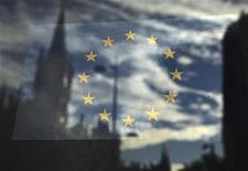 <p>The European Union flag is pictured in a window reflecting a street in London, October 26, 2011. REUTERS/Luke MacGregor</p>