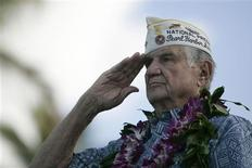 <p>Pearl Harbor Survivors' President William Muelhieb salutes the Color Guard during the 70th anniversary of the attack on Pearl Harbor at the World War II Valor in the Pacific National Monument in Honolulu, Hawaii December 7, 2011. REUTERS/Hugh Gentry</p>