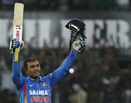 India's captain Virender Sehwag celebrates after scoring 200 runs during their fourth one-day international cricket match against West Indies in Indore December 8, 2011. REUTERS/Amit Dave