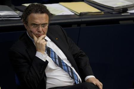 German Interior Minister Hans-Peter Friedrich attends a session of the Bundestag, the lower house of parliament in Berlin, about a neo-Nazi group that had been on a nationwide ten-year killing spree, November 22, 2011. REUTERS/Thomas Peter