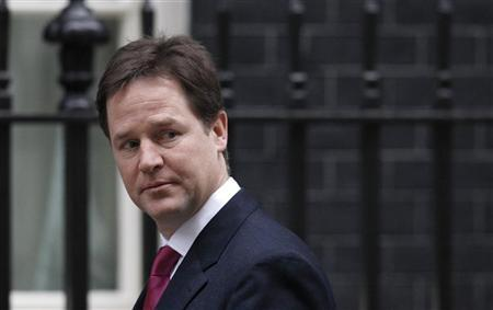 Deputy Prime Minister Nick Clegg arrives for a cabinet meeting at 10 Downing Street in London November 29, 2011. REUTERS/Suzanne Plunkett