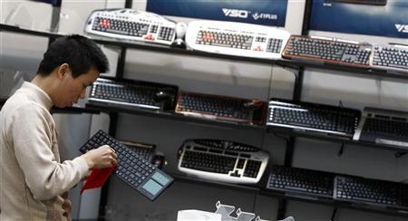 A man cleans a keyboard at the stand of VSO Technology at the CeBIT exhibition centre in Hanover March 1, 2010. REUTERS/Fabrizio Bensch