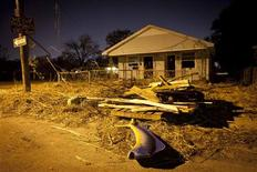 <p>Debris, including a stuffed fish, sits in front of a blighted house in the Lower Ninth Ward of New Orleans, December 1, 2011. REUTERS/Lee Celano</p>