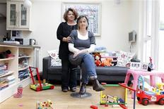 <p>Linda Cullen (L) and her partner Feargha Ni Bhroin pose in their house in the village of Blackrock in South County Dublin November 2, 2011. REUTERS/Cathal McNaughton</p>