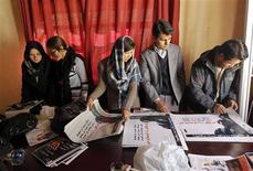 <p>Members of activist group YoungWomen4Change arrange posters demanding rights for women in Kabul December 23, 2011. REUTERS/Omar Sobhani</p>