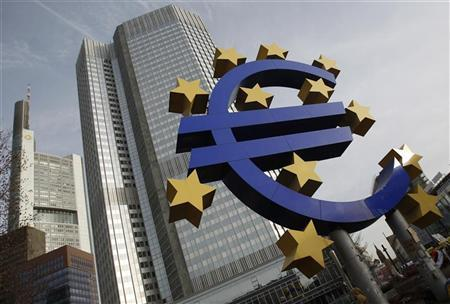 A sculpture showing the Euro currency sign is seen in front of the European Central Bank (ECB) headquarters in Frankfurt December 8, 2011. REUTERS/Alex Domanski