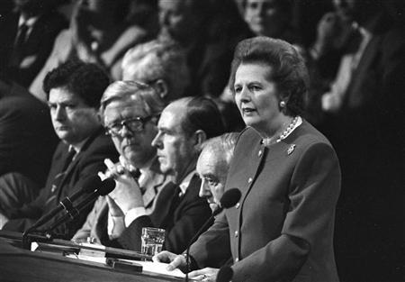 Margaret Thatcher gives the final address of the Conservative Convention in Brighton on October 14, 1988. Listening are L to R: Chancellor of the Exchequer Nigel Lawson, Foreign Secretary Sir Geoffrey Howe, party Chairman Peter Brooke. REUTERS/Andy Clark