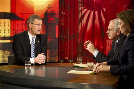 German President Christian Wulff is pictured during the recording of a television interview with journalists Bettina Schausten (R) and Ulrich Deppendorf (C) at the ARD main TV studios in Berlin, January 4, 2012. REUTERS/Bundesregierung/Jesco Denzel/Pool