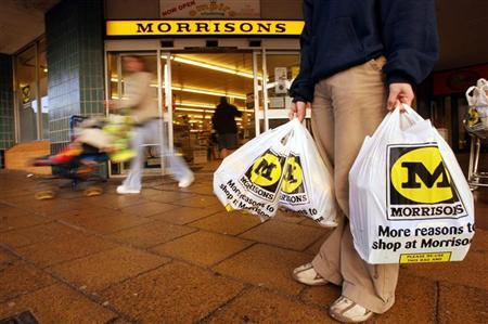 A shopper leaves with her groceries at the Morrisons supermarket in Bradford City centre, January 9, 2003. REUTERS/Ian Hodgson