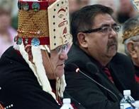 <p>Hereditary Chief of the Haisla First Nation, Sam Robinson (L), testifies next to Henry Amos, a band councillor, before the Enbridge's Inc's Northern Gateway pipeline Joint Review hearing in Kitamaat Village, British Columbia, January 10, 2012. Aboriginal leaders opposed to a C$5.5 billion ($5.4 billion) oil sands pipeline backed by Canada's government warned on Tuesday that the project could devastate fishing and traditional life on the rugged Pacific Coast and called for it to be stopped. REUTERS/Robin Rowland</p>