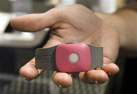 A Tagg - The Pet Tracker GPS pet collar is displayed at the Qualcomm booth during the 2012 International Consumer Electronics Show (CES) in Las Vegas, Nevada, January 12, 2012. REUTERS/Steve Marcus