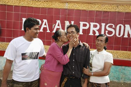 Burmese blogger Nay Phone Latt's grandmother (2nd L) kisses him as he reunites with his mother (R) and elder brother (L) in front of Pa-an prison, in Pa-an January 13, 2012. REUTERS/Soe Zeya Tun