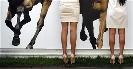 Racegoers are seen at the bar on Ladies Day, the third day of the Royal Ascot race meeting in southern England June 16, 2011. REUTERS/Eddie Keogh
