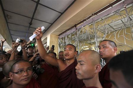 Shin Gambira, leader of the All-Burmese Monks Alliance who was recently released, talks to supporters while attending the court hearing of Pyi Nyar Thiha, the head of Shwenyawar monastery, in the state committee of Sangha Maha Nayaka in Yangon January 19, 2012. REUTERS/Soe Zeya Tun