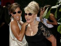 <p>Actors Melissa Rivers (L) and Joan Rivers smile as they arrive for the 58th annual Primetime Emmy Awards at the Shrine Auditorium in Los Angeles August 27, 2006. REUTERS/Fred Prouser</p>