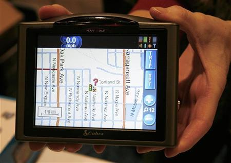 The Cobra Nav One 5000 portable mobile navigation system is displayed at the Consumer Electronics Show (CES) Unveiled event in Las Vegas, Nevada January 5, 2008. REUTERS/Rick Wilking