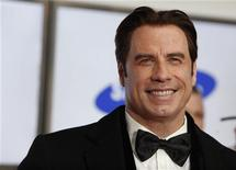 <p>U.S. actor John Travolta arrives on the red carpet for the 46th 'Goldene Kamera' (Golden Camera) awards ceremony at the Ullstein Auditorium in Berlin, February 5, 2011. REUTERS/Thomas Peter</p>
