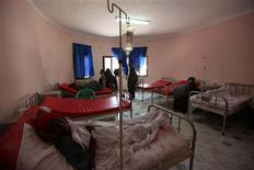 <p>Somali patients receive treatment in a hospital run by the SOS Children's Village charity, which receives food rations from the Iranian Red Crescent, in Mogadishu January 10, 2012. REUTERS/Feisal Omar</p>