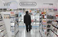 <p>A man walks past Nintendo Co. Ltd.'s video game software titles at a Yamada Denki electronics retail store in Tokyo January 26, 2012. REUTERS/Toru Hanai</p>