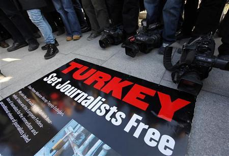 Journalists and their supporters gather outside the Justice Palace to protest against the detention of journalists in Istanbul December 26, 2011. REUTERS/Murad Sezer