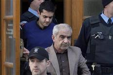 <p>Mohammad Shafia (C) and his son Hamed Shafia (top) leave the Frontenac County Courthouse in Kingston, Ontario January 29, 2012. REUTERS/Lars Hagberg</p>