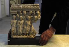 <p>An Afghan specialist displays an ancient pre-Islamic sculpture that was returned to Afghanistan at the Afghan National Museum in Kabul January 30, 2012. REUTERS/Omar Sobhani</p>