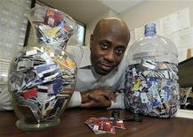 <p>Credit Canada counsellor Randolph Taylor poses with jars of cut-up client credit cards at his office in Toronto January 30, 2012. The two jars are filled with shards of credit cards, chopped up by the clients whose staggering indebtedness drove them to the front line of Canada's household debt crisis. The growth of household debt in Canada to levels approaching those seen in the United States before the 2008-2009 crash seems to be keeping a lot of people awake - from central bankers to economists, lenders, real estate agents and the indebted consumers. Picture taken January 30, 2012. REUTERS/Mike Cassese</p>