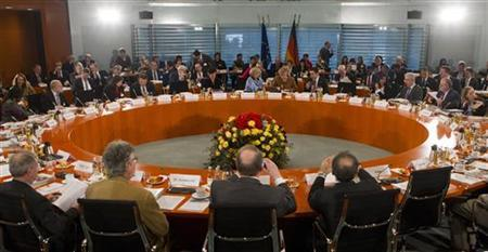 German Chancellor Angela Merkel (background C) opens an integration summit at the Chancellery in Berlin, January 31, 2012. REUTERS/Thomas Peter (GERMANY - Tags: POLITICS)