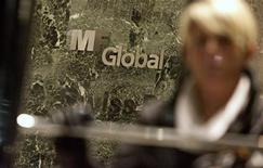 <p>A woman leaves the office complex where MF Global Holdings Ltd have an office on 52nd Street in midtown Manhattan October 29, 2011. REUTERS/Andrew Kelly</p>