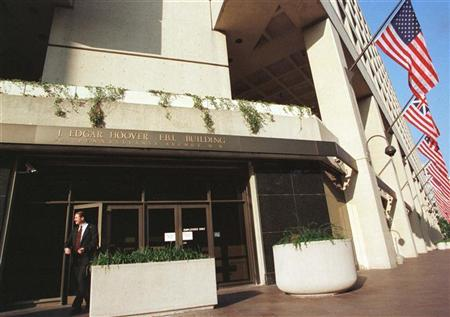 A man walks out of the Federal Bureau of Investigations (FBI) headquarters in Washington, July 23, 1999. Reuters/Jamal Wilson