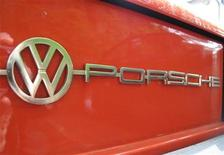 <p>The sign VW-Porsche is pictured at the back of a VW-Porsche 914 car at a dealer in Bochum May 7, 2009. The car was a joint production of Volkswagen and Porsche between circa 1969 and 1976. REUTERS/Ina Fassbender (GERMANY TRANSPORT)</p>