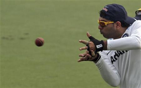 India's Yuvraj Singh catches the ball during a practice session ahead of their first test cricket match against West Indies in New Delhi November 5, 2011. REUTERS/Stringer